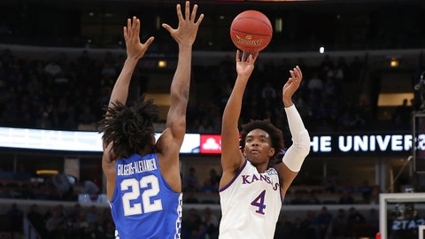 Nov 14, 2017; Chicago, IL, USA; Kansas Jayhawks guard Devonte' Graham (4) shoots over Kentucky Wildcats guard Shai Gilgeous-Alexander (22) during the first half at United Center. Mandatory Credit: Dennis Wierzbicki-USA TODAY Sports