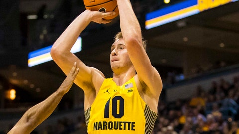 Nov 14, 2017; Milwaukee, WI, USA; Marquette Golden Eagles guard Sam Hauser (10) shoots over Purdue Boilermakers guard P.J. Thompson (11) during the first half at BMO Harris Bradley Center. Mandatory Credit: Jeff Hanisch-USA TODAY Sports