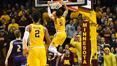 Minnesota guard Amir Coffey (5) dunks the ball against Western Carolina during the first half of an NCAA college basketball game Sunday, Nov. 19, 2017, in Minneapolis. (AP Photo/John Autey)
