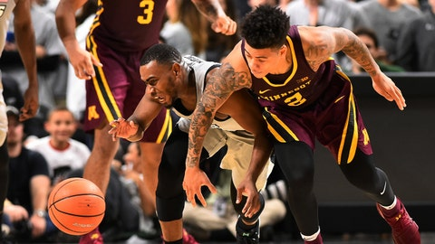 Nov 13, 2017; Providence, RI, USA; Minnesota Golden Gophers guard Nate Mason (2) and and Providence Friars guard Kyron Cartwright (24) reach scramble for a loose ball during the second half at the Dunkin Donuts Center. Mandatory Credit: Brian Fluharty-USA TODAY Sports