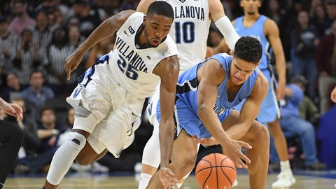 Nov 10, 2017; Philadelphia, PA, USA; Villanova Wildcats guard Mikal Bridges (25) tries to steal ball from Columbia Lions forward Myles Hanson (31) during the first half at Wells Fargo Center. Mandatory Credit: Eric Hartline-USA TODAY Sports