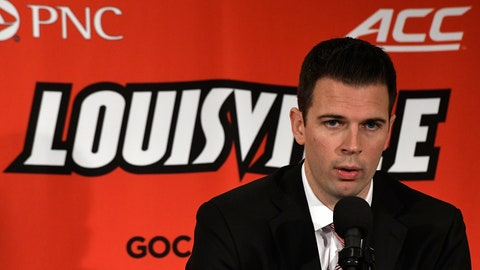 Louisville acting head coach David Padgett answers a question during an NCAA college basketball media day, Sunday, Oct. 29, 2017, in Louisville, Ky. (AP Photo/Timothy D. Easley)