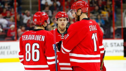 Dec 23, 2016; Raleigh, NC, USA;  Carolina Hurricanes forward Jordan Staal (11) forward Teuvo Teravainen (86) and forward Sebastian Aho (20) talk during a timeout against the Boston Bruins at PNC Arena. The Carolina Hurricanes defeated the Boston Bruins 3-2 in the overtime. Mandatory Credit: James Guillory-USA TODAY Sports