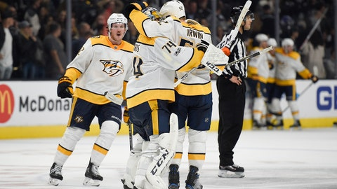 Nov 4, 2017; Los Angeles, CA, USA; Nashville Predators defenseman Matt Irwin (52) celebrates with Nashville Predators goalie Juuse Saros (74) after their 4-3 win against the Los Angeles Kings at Staples Center. Mandatory Credit: Kelvin Kuo-USA TODAY Sports