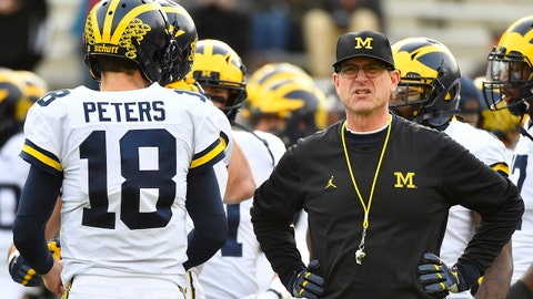 Nov 11, 2017; College Park, MD, USA; Michigan Wolverines head coach Jim Harbaugh talks with quarterback Brandon Peters (18) before the game against the Maryland Terrapins at Maryland Stadium. Mandatory Credit: Brad Mills-USA TODAY Sports