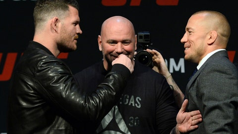 Mar 3, 2017; Las Vegas, NV, USA; Dana White (middle) stands between Michael Bisping (left) and Georges St-Pierre (right) during a press conference to promote their about prior to weigh ins for UFC 209 at T-Mobile Arena. Mandatory Credit: Joe Camporeale-USA TODAY Sports
