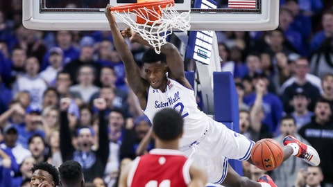 Nov 15, 2017; Newark, NJ, USA; Seton Hall Pirates guard Myles Cale (22) hangs on the rim after a dunk during the first half against the Indiana Hoosiers at Prudential Center. Mandatory Credit: Vincent Carchietta-USA TODAY Sports