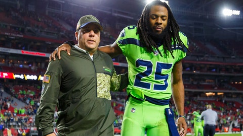 Nov 9, 2017; Glendale, AZ, USA; Seattle Seahawks cornerback Richard Sherman (25) is helped off the field after the game by a coach after rupturing his Achilles tendon against the Arizona Cardinals at University of Phoenix Stadium. Mandatory Credit: Mark J. Rebilas-USA TODAY Sports