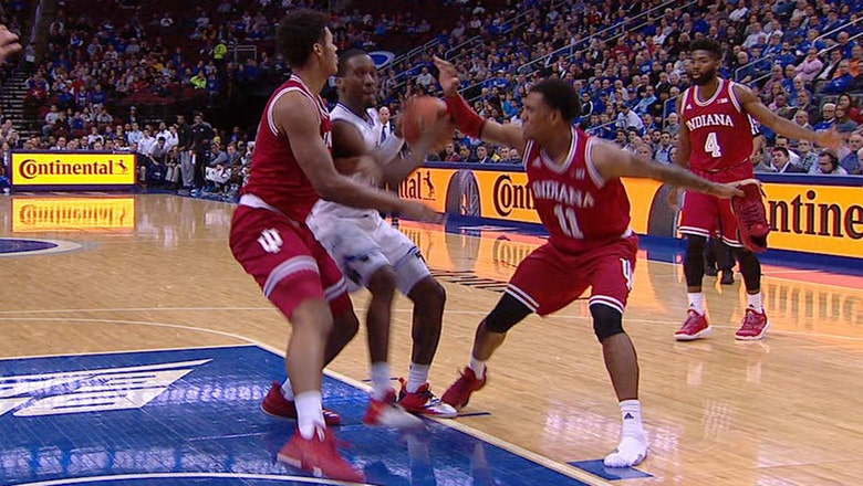 Indiana's Devonte Green comes up with a steal while holding his shoe