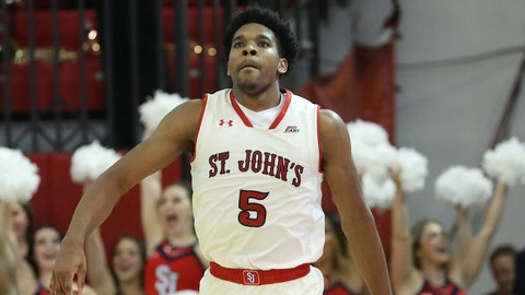 Nov 16, 2017; Queens, NY, USA;St. John's Red Storm guard Justin Simon (5) reacts after scoring during the first half against the Nebraska Cornhuskers at Carnesecca Arena. Mandatory Credit: Anthony Gruppuso-USA TODAY Sports