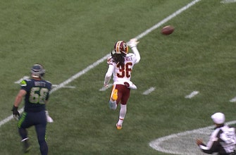 Washington's DJ Swearinger and Josh Norman lateral the ball back and forth after intercepting Seattle's 2-point attempt