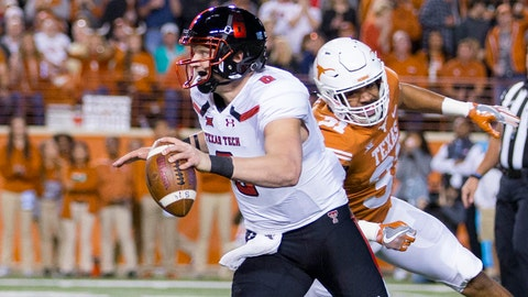 Nov 24, 2017; Austin, TX, USA; Texas Tech Red Raiders quarterback McLane Carter (6) is chased by Texas Longhorns defensive end Malcolm Roach (32) during the first quarter at Darrell K Royal-Texas Memorial Stadium. Mandatory Credit: John Gutierrez-USA TODAY Sports
