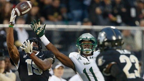 Nov 24, 2017; Orlando, FL, USA; UCF Knights defensive back Mike Hughes (19) intercepts a pass intended for South Florida Bulls wide receiver Marquez Valdes-Scantling (11) as Knights defensive back Tre Neal (23) looks on during the second quarter at Spectrum Stadium. Mandatory Credit: Reinhold Matay-USA TODAY Sports