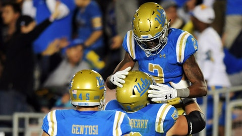 Nov 24, 2017; Pasadena, CA, USA; UCLA Bruins offensive lineman Scott Quessenberry (52) celebrates after Bruins wide receiver Jordan Lasley (2) scored a touchdown against California Golden Bears in the second half during an NCAA football game at Rose Bowl. Mandatory Credit: Kirby Lee-USA TODAY Sports