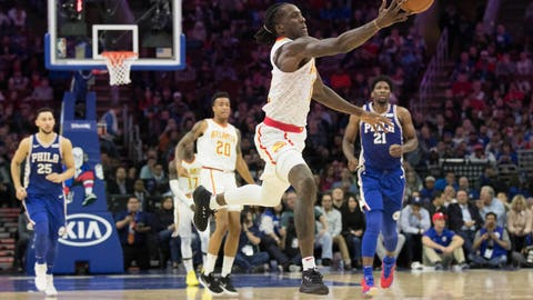 Nov 1, 2017; Philadelphia, PA, USA; Atlanta Hawks forward Taurean Prince (12) lunges for a long pass during the second quarter against the Philadelphia 76ers at Wells Fargo Center. Mandatory Credit: Bill Streicher-USA TODAY Sports