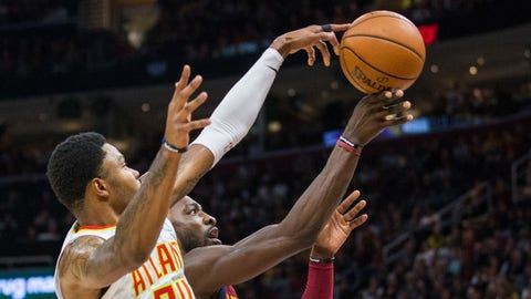 Nov 5, 2017; Cleveland, OH, USA; Atlanta Hawks guard Kent Bazemore (24) blocks a shot by Cleveland Cavaliers forward Jeff Green (32) during the first quarter at Quicken Loans Arena. Mandatory Credit: Scott R. Galvin-USA TODAY Sports