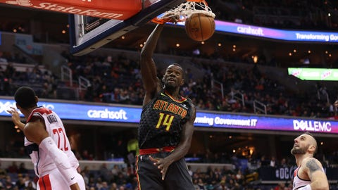 Nov 11, 2017; Washington, DC, USA; Atlanta Hawks center Dewayne Dedmon (14) dunks the ball as Washington Wizards forward Otto Porter Jr. (22) and Wizards center Marcin Gortat (13) look on in the third quarter at Capital One Arena. The Wizards won 113-94. Mandatory Credit: Geoff Burke-USA TODAY Sports