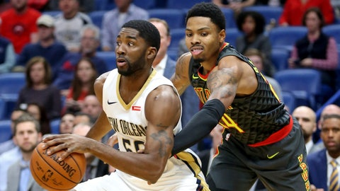 Nov 13, 2017; New Orleans, LA, USA; Atlanta Hawks guard Kent Bazemore (24) tries to steal the ball from New Orleans Pelicans guard E'Twaun Moore (55) in the first quarter at the Smoothie King Center. Mandatory Credit: Chuck Cook-USA TODAY Sports