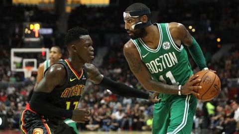 Nov 18, 2017; Atlanta, GA, USA; Boston Celtics guard Kyrie Irving (11) moves against Atlanta Hawks guard Dennis Schroder (17) in the fourth quarter at Philips Arena. Mandatory Credit: Jason Getz-USA TODAY Sports
