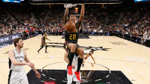 Nov 20, 2017; San Antonio, TX, USA; Atlanta Hawks power forward John Collins (20) dunks the ball past San Antonio Spurs shooting guard Danny Green (14) during the first half at AT&T Center. Mandatory Credit: Soobum Im-USA TODAY Sports
