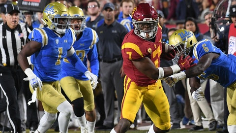 Nov 18, 2017; Los Angeles, CA, USA; Southern California Trojans running back Stephen Carr (7) runs away from UCLA Bruins defensive back Adarius Pickett (6)  in the second half at Los Angeles Memorial Coliseum. Mandatory Credit: Richard Mackson-USA TODAY Sports