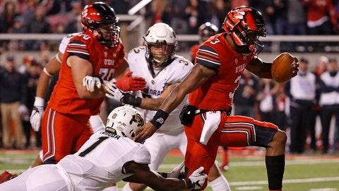 Nov 25, 2017; Salt Lake City, UT, USA; Utah Utes quarterback Troy Williams (3) breaks away past Colorado Buffaloes defensive back Afolabi Laguda (1) for a second quarter touchdown at Rice-Eccles Stadium. Mandatory Credit: Jeff Swinger-USA TODAY Sports