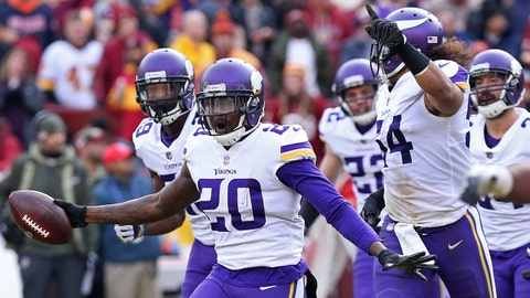 Nov 12, 2017; Landover, MD, USA; Minnesota Vikings cornerback Mackensie Alexander (20) celebrates with teammates after intercepting a pass against the Washington Redskins in the second quarter at FedEx Field. Mandatory Credit: Geoff Burke-USA TODAY Sports