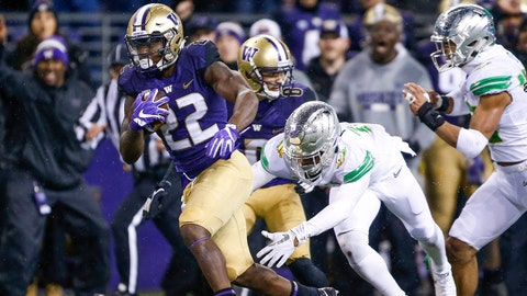 Nov 4, 2017; Seattle, WA, USA; Washington Huskies running back Lavon Coleman (22) breaks a tackle by Oregon Ducks cornerback Deommodore Lenoir (15) on a reception for a 31-yard touchdown during the third quarter at Husky Stadium. Mandatory Credit: Jennifer Buchanan-USA TODAY Sports