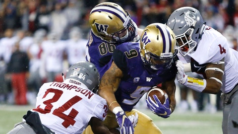 Nov 25, 2017; Seattle, WA, USA; Washington State Cougars safety Jalen Thompson (34) and defensive back Marcus Strong (4) can't stop Washington Huskies running back Myles Gaskin (9) from scoring a touchdown during the first quarter at Husky Stadium. Mandatory Credit: Jennifer Buchanan-USA TODAY Sports