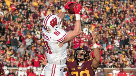 Nov 25, 2017; Minneapolis, MN, USA; Wisconsin Badgers tight end Troy Fumagalli (81) jumps up and catches a touchdown pass over Minnesota Golden Gophers linebacker Julian Huff (20) in the first half at TCF Bank Stadium. Mandatory Credit: Jesse Johnson-USA TODAY Sports