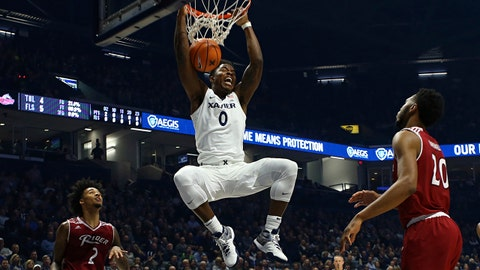 Xavier Musketeers forward Tyrique Jones dunks the ball after making a move past Rider Broncs guard Jordan Allen during the first half of an NCAA college basketball game, Monday, Nov. 13, 2017, in Cincinnati. (AP Photo/Aaron Doster)