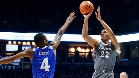 Xavier's Kaiser Gates (22) shoots against Hampton's Greg Heckstall (4) in the first half of an NCAA college basketball game, Monday, Nov. 20, 2017, in Cincinnati. (AP Photo/John Minchillo)