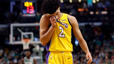 Los Angeles Lakers' Lonzo Ball wipes his face late in the fourth quarter of the Lakers' 107-96 loss to the Boston Celtics in an NBA basketball game in Boston on Wednesday, Nov. 8, 2017. (AP Photo/Winslow Townson)