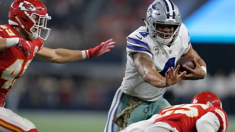 Kansas City Chiefs' Daniel Sorensen (49) and Kenneth Acker (25) attempt to stop Dallas Cowboys' Dak Prescott (4) as he runs the ball in the second half of an NFL football game, Sunday, Nov. 5, 2017, in Arlington, Texas. (AP Photo/Brandon Wade)