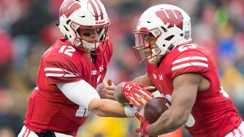 Nov 18, 2017; Madison, WI, USA; Wisconsin Badgers quarterback Alex Hornibrook (12) hands the football off to running back Jonathan Taylor (23) during the first quarter against the Michigan Wolverines at Camp Randall Stadium. Mandatory Credit: Jeff Hanisch-USA TODAY Sports