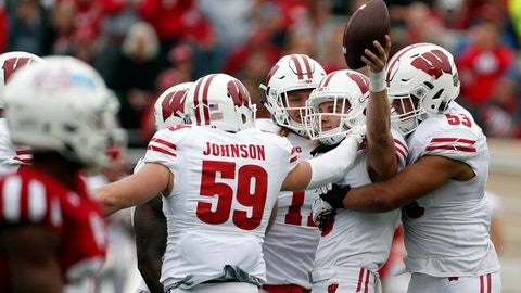 Nov 4, 2017; Bloomington, IN, USA;  Wisconsin Badgers safety Joe Ferguson (8) is congratulated by his teammates after intercepting a pass against the Indiana Hoosiers at Memorial Stadium. Mandatory Credit: Brian Spurlock-USA TODAY Sports