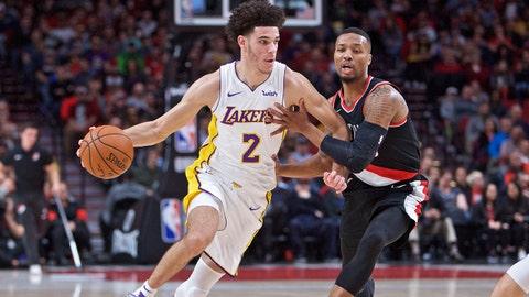 Nov 2, 2017; Portland, OR, USA; Los Angeles Lakers guard Lonzo Ball (2) dribbles past Portland Trail Blazers guard Damian Lillard (0) during the first quarter at the Moda Center. Mandatory Credit: Craig Mitchelldyer-USA TODAY Sports