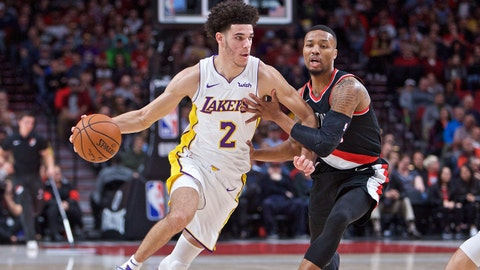 Nov 2, 2017; Portland, OR, USA; Los Angeles Lakers guard Lonzo Ball (2) dribbles past Portland Trail Blazers guard Damian Lillard (0) during the first quarter at the Moda Center. Mandatory Credit: Craig Mitchelldyer-USA TODAY Sports