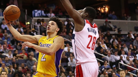 Nov 9, 2017; Washington, DC, USA; Los Angeles Lakers guard Lonzo Ball (2) shoots the ball as Washington Wizards center Ian Mahinmi (28) defends in the third quarter at Capital One Arena. The Wizards won 111-95. Mandatory Credit: Geoff Burke-USA TODAY Sports