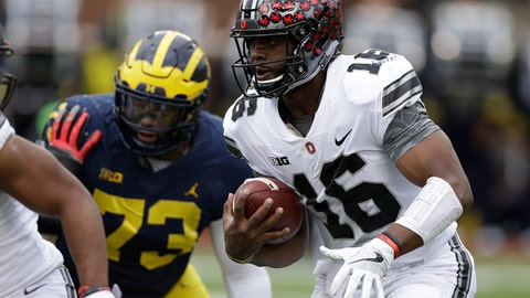Ohio State quarterback J.T. Barrett (16) rushes during the first half of an NCAA college football game against Michigan, Saturday, Nov. 25, 2017, in Ann Arbor, Mich. (AP Photo/Carlos Osorio)