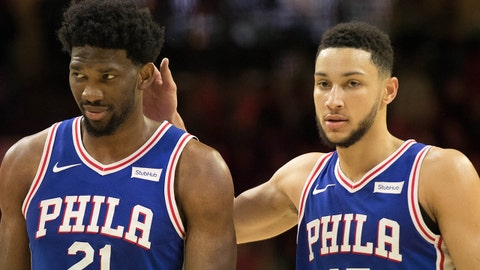 Nov 20, 2017; Philadelphia, PA, USA; Philadelphia 76ers center Joel Embiid (21) walks the floor with guard Ben Simmons (25) after drawing a technical foul against Utah Jazz guard Donovan Mitchell (not pictured) during the fourth quarter at Wells Fargo Center. Mandatory Credit: Bill Streicher-USA TODAY Sports