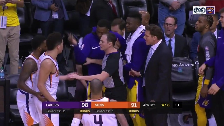Devin Booker exchanges words with Lakers' bench