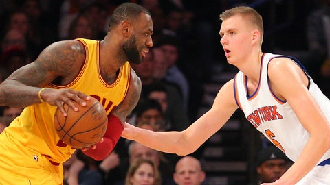 Mar 26, 2016; New York, NY, USA; Cleveland Cavaliers small forward LeBron James (23) controls the ball against New York Knicks power forward Kristaps Porzingis (6) during the third quarter at Madison Square Garden. Mandatory Credit: Brad Penner-USA TODAY Sports