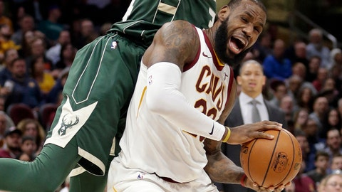 Cleveland Cavaliers' LeBron James, right, is fouled by Milwaukee Bucks' Giannis Antetokounmpo, from Greece, in the first half of an NBA basketball game, Tuesday, Nov. 7, 2017, in Cleveland. (AP Photo/Tony Dejak)