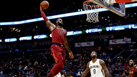 Oct 28, 2017; New Orleans, LA, USA; Cleveland Cavaliers forward LeBron James (23) dunks over New Orleans Pelicans forward DeMarcus Cousins (0) during the first half of a game at the Smoothie King Center. Mandatory Credit: Derick E. Hingle-USA TODAY Sports