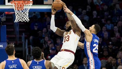 Nov 27, 2017; Philadelphia, PA, USA; Cleveland Cavaliers forward LeBron James (23) attempts a shot while fouled by Philadelphia 76ers guard Ben Simmons (25) during the first quarter at Wells Fargo Center. Mandatory Credit: Bill Streicher-USA TODAY Sports
