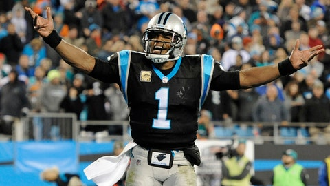 Carolina Panthers' Cam Newton (1) fires up the fans after a Panthers touchdown against the Miami Dolphins in the second half of an NFL football game in Charlotte, N.C., Monday, Nov. 13, 2017. (AP Photo/Mike McCarn)