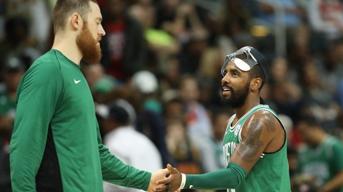Nov 18, 2017; Atlanta, GA, USA; Boston Celtics guard Kyrie Irving (11) celebrates a play with center Aron Baynes (46) in the fourth quarter against the Atlanta Hawks at Philips Arena. Mandatory Credit: Jason Getz-USA TODAY Sports