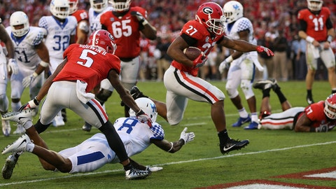 Georgia running back Nick Chubb (27) gets past Kentucky cornerback Derrick Baity (8) to score in the first half of an NCAA college football game Saturday, Nov. 18, 2017, in Athens, Ga. (AP Photo/John Bazemore)