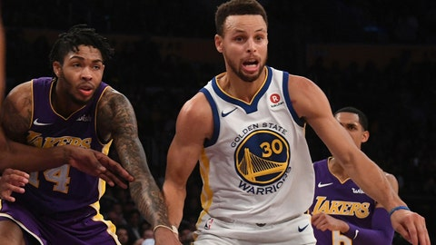 Nov 29, 2017; Los Angeles, CA, USA; Golden State Warriors guard Stephen Curry (30) and Los Angeles Lakers forward Brandon Ingram (14) eye a loose ball during overtime at Staples Center. Mandatory Credit: Richard Mackson-USA TODAY Sports